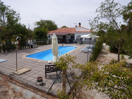 The house with the pool and sundeck
