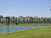 view to apartments from golf course